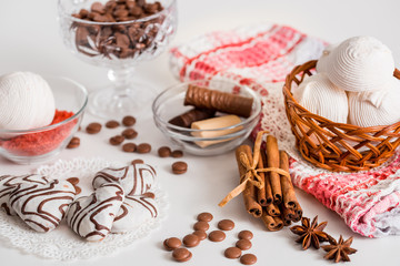 Black tea with cookies and cinnamon on a white wooden background