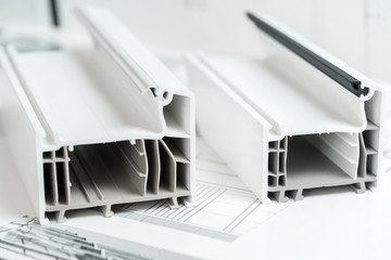 A cross section of pvc window. PVC window profile cut. Design of pvc profiles for window, technical drawing on background