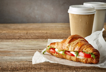croissant sandwich with tomato and mozzarella