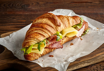 Croissant sandwich with cheese and ham