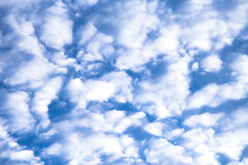 Puffy white clouds against a blue sky.