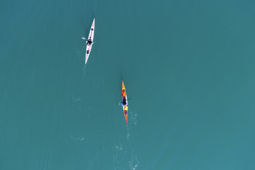 Two kayaks are competing in the ocean
