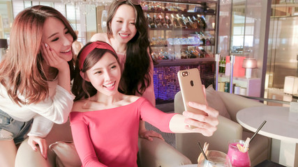 women selfie in restaurant