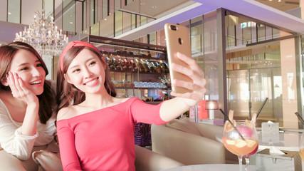 women selfie in restaurant