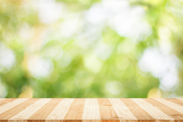 Wooden tabletop with fresh green nature