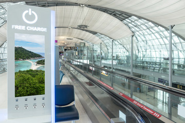 photo advertising billboard and charge station at airport