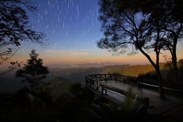 "Beautiful scenery of the startrail on night sky at ""kooddoi hill"", Thongphaphum national park , kanchanaburi province in Thailand is a very popular for photographers and tourists.."