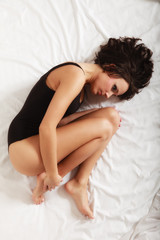 Sad girl lonely woman lying on bed in bedroom