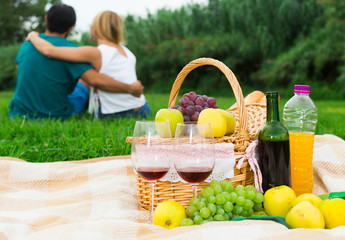 Image of picnic on the grass for lovely couple