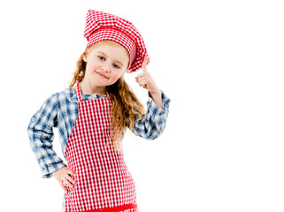Little cute chef girl pointing up isolated on white background