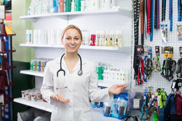 Female vet advising on pet cosmetics in pet store