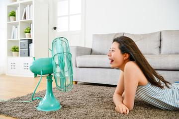 beautiful woman face to electric fan shouting