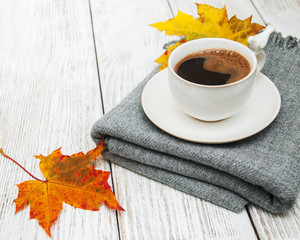 Cup of coffee and autumn leaves