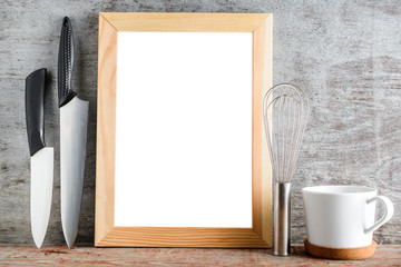 empty wooden frame and kitchen accessories on a wooden table. layout for your design