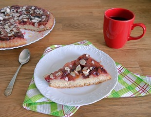 Delicate plum pie with almond crumbs