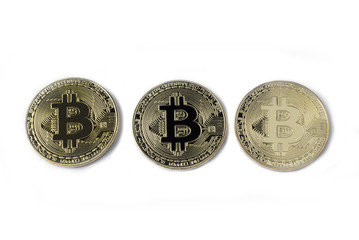 Studio shot three golden Bitcoin, Cryptocurrency, isolated on white background.