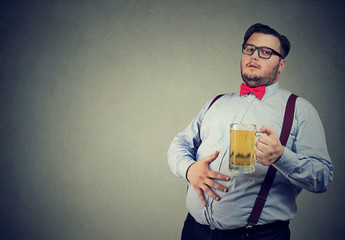Obese young man full with beer