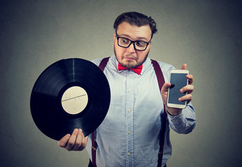 Man confused with new and old technology