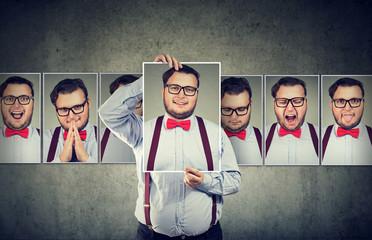 Man having mood swings posing at camera