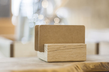 Kraft paper texture blank name card on wood stand, selective focus