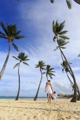 A woman with a son on a Bavaro beach in Punta Cana region of Dominican Republic