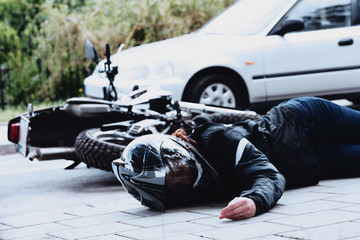 Dead motorcyclist on the road Wall mural