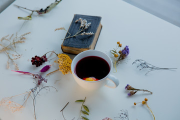 Cup, Bible and herbs