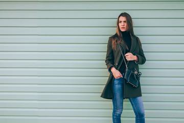 Beautiful young woman in green coat