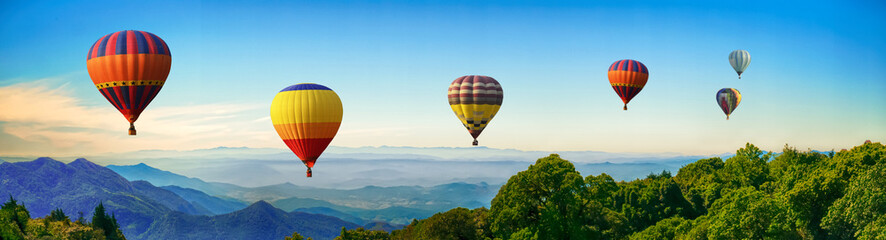 Poster Balloon Panorama of mountain with hot air balloons on morning at Thailand.