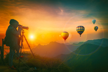 Photographer are shooting balloons at sunrise.