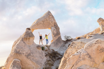 happy friends travelling and having fun in Goreme national park in Cappadocia fairy chimneys in Turkey
