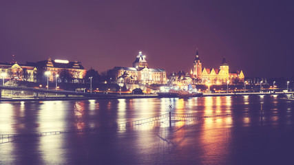 Szczecin (Stettin) City at night, vintage toned picture, Poland.