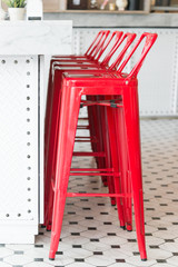 Modern metal red chair with marble counter