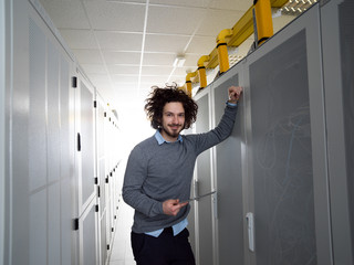 IT engineer working on a tablet computer in server room