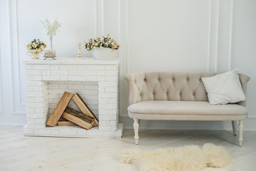 minimalism interior. white living room with a fireplace