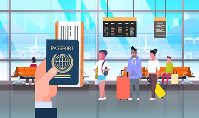 Hand Hold Passport And Ticket Over People In Airport On Backgroound Travelers With Baggage At Waiting Hall Flat Vector Illustration
