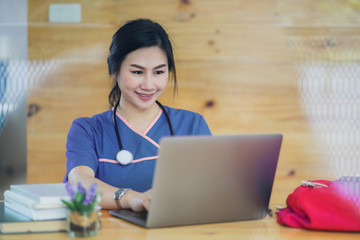 Female nurse at a desk working in a modern office