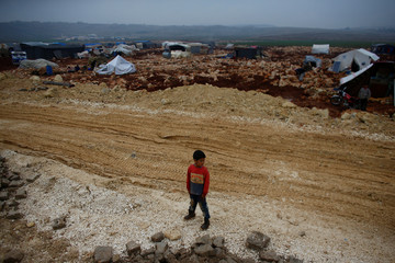 A displaced Syrian boy is pictured at Kelbit refugee camp in Idlib province