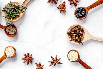 Dry colorful spices, vanilla, cinnamonon kitchen stone table bac