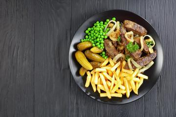 tasty fried veal liver and vegetables
