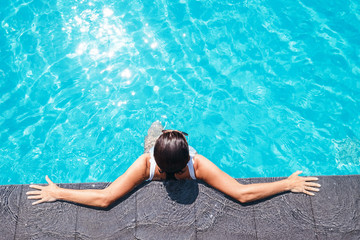 Woman enjoy the sun in swimming pool
