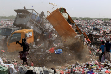The Wider Image: Displaced Yemeni family sift through garbage for food