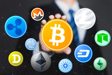Businessman holding a symbol of cryptocurrency, Business concept of worldwide cryptocurrency.