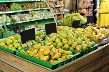 Variety of fresh ripe fruits in supermarket