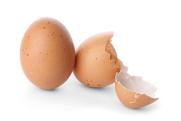 Chicken egg and cracked shell on white background
