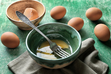 Composition with chicken eggs on wooden table