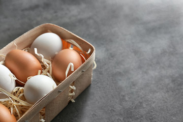 Chicken eggs in package on table