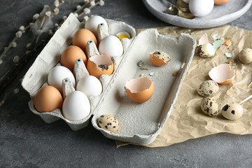 Chicken and quail eggs in package on table