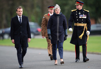 France's President Emmanuel Macron and Britain's Prime Minister Theresa May arrive at Sandhurst Military Academy in Sandhurst