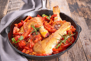 chicken leg cooked with tomato and bell pepper
